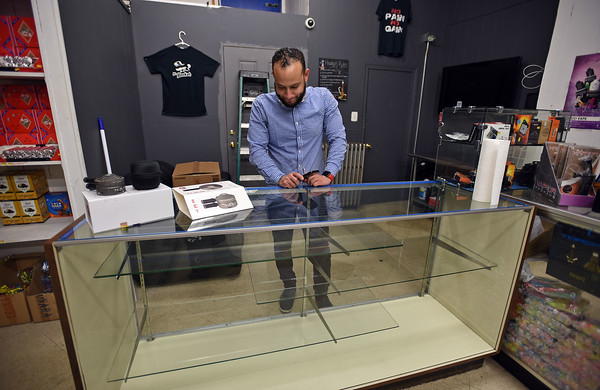 RYAN HUTTON/ Staff photo <br /> Robert Diaz, owner of Mr Hookah on Broadway in Methuen, looks at his now-empty display case in his shop on Thursday after Gov. Charlie Baker declared a public health emergency and banned the sale of vaping merchandise and e-cigarettes until January.