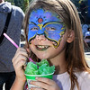 CARL RUSSO/Staff photo. Sophia Murphy, 8, of Haverhill stays cool with some slush. Team Haverhill's River Ruckus 2019 was held Saturday in downtown Haverhill on Washington Street. 9/21/2019