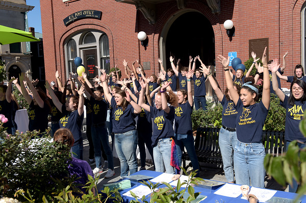 TIM JEAN/Staff photo<br /> <br /> Members of Andover Vocal Music sing and dance during community gathering on the anniversary of the Sept. 13, 2018 gas disaster outside the Old Town Hall in Andover.  9/13/19