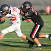 CARL RUSSO/Staff photo. North Andover's Jake Wolinski slows down  Marblehead's Tim Cronin allowing Wolinski's teammates to help make the tackle for a loss on yards.  Marblehead defeated North Andover 25-20 in Friday football action. 9/12/2019