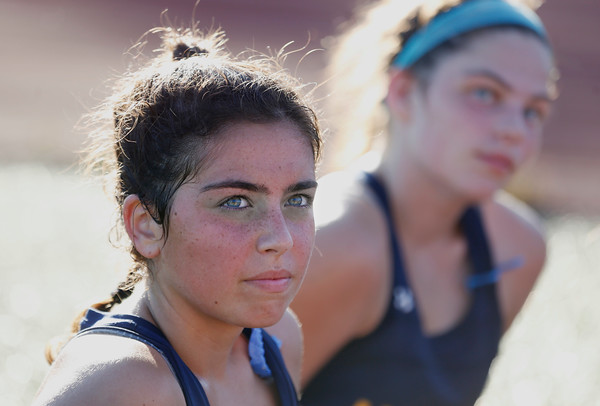 MIKE SPRINGER/Staff photo<br /> Andover's Heather Graham listens to the coach following a varsity field hockey match Wednesday at North Andover. At right is Graham's teammate Emma Reilly.<br /> 9/25/2019