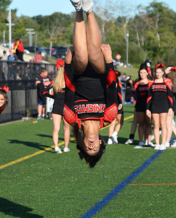 CARL RUSSO/Staff photo. ANDOVERS' MAGAZINE:  North Andover high senior football cheerleading captain, Alana Myers, somersaults down the sidelines during the game.  Marblehead defeated North Andover 25-20 in Friday football action. 9/13/2019