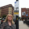 RYAN HUTTON/ Staff photo <br /> Lisa Corr stands in front of one of the city's 2-hour parking signs on Essex Street in Haverhill. Corr says she recently got a ticket after moving parking spots.