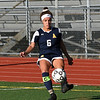 RYAN HUTTON/ Staff photo <br /> Andover's Olivia Schwinn-Clanton kicks the ball inbounds during Thursday's home game against Central Catholic High School.