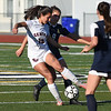 RYAN HUTTON/ Staff photo <br /> Central Catholic's Juliana Porto, left, battles Andover's Anna Riley for the ball at midfield during Thursday's game at Andover High School.