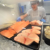 CARL RUSSO/staff photo. READING MAG: Stephen Hansen, 17, a senior at Masconomet's Regional high school loads the fish case with plenty of haddock,   salmon, swordfish steaks and shrimp. <br /> <br /> The Lobster Claw, a North Reading family owned restaurant since 1976 was Started by Harry Gresek. His sons, Victor Gresek and Luke Gresek continue the family business after Harry's passing. The two brothers took over three years ago. The restaurant is known for its chowders and sauces and fresh seafood. 9/12/2019