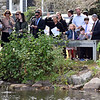 RYAN HUTTON/ Staff photo <br /> Members of Tempel Emanu-el toss bread into Round Pond after their Rosh Hashanah service on Monday morning, an act that symbolizes casting away sins for the Jewish New Year.