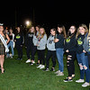 CARL RUSSO/Staff photo Miss New Hampshire 2019, Sarah Tubbs of Sandown leads the way as Windham  students get ready to greet cancer survivors and their families with flowers during the 9th Annual Windham high Jaguar Blackout Cancer Football Game and half time show. The popular event was held Friday night on September 27. <br /> <br /> Windham grown Project Blackout kicks off a series of events around the town to generate awareness of pediatric cancer and raise funds to support research efforts and care for the children and families currently battling pediatric cancer in Windham. Students performed at the football game halftime show dedicated to families who have been helped by the project. 9/27/2019