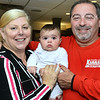 CARL RUSSO/Staff photo. Methuen mayoral candidate, Jennifer Kannan with her husband Bill and their granddaughter, Eleanor Souza, nine-months-old celebrate at the Sand Bar Restaurant in the Merrimack Valley Golf Club. Kannan captured second place in the September primary election Tuesday night. 9/17/2019
