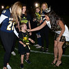 CARL RUSSO/Staff photo Miss New Hampshire 2019, Sarah Tubbs of Sandown greets cancer survivor Cayden Murray, 6 as he walks onto the field with his sisters, Regan,15, left and Sophia, 11(behind him) during the half time show of the 9th Annual Windham high Jaguar Blackout Cancer Football Game. The popular event was held Friday night on September 27.<br /> <br /> Windham-grown Project Blackout kicks off a series of events around the town to generate awareness of pediatric cancer and raise funds to support research efforts and care for the children and families currently battling pediatric cancer in Windham. Students performed at the football game halftime show dedicated to families who have been helped by the project. 9/27/2019