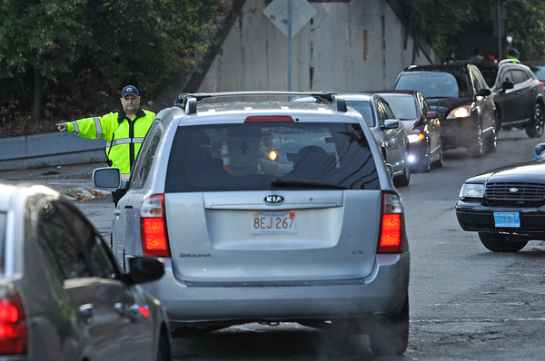TIM JEAN/Staff photo<br /> <br /> Lawrence police officers direct traffic along Andover Street on Friday morning after a reported major gas leak caused a lockdown and evacuation of the South Lawrence.   9/27/19