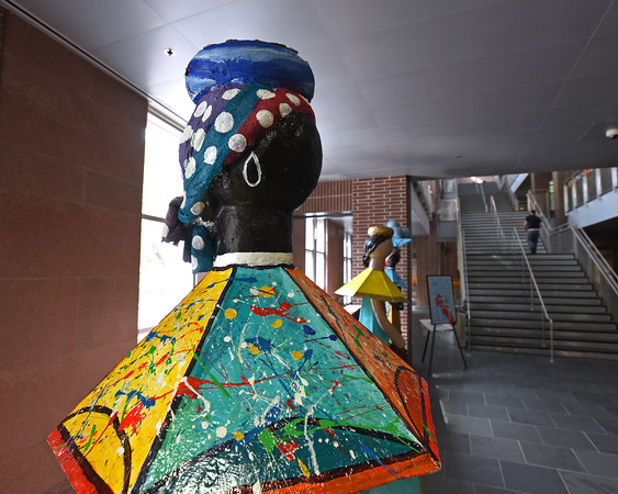 RYAN HUTTON/ Staff photo <br /> Giant Muñecas Limé dolls from the Dominican Republic watches over entrance of Lawrence District Court on Monday as part of Cultural Appreciation Week which celebrates the diversity of the court.
