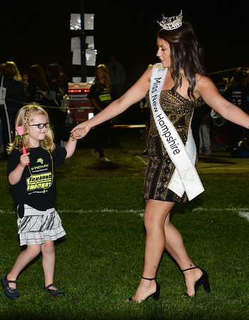 CARL RUSSO/Staff photo Cancer survivor Nora Flaherty, 6 of Windham dances with Miss New Hampshire 2019, Sarah Tubbs of Sandown  during the half time show of the 9th Annual Windham high Jaguar Blackout Cancer Football Game on Friday night, September 27. <br /> <br /> Windham-grown Project Blackout kicks off a series of events around the town to generate awareness of pediatric cancer and raise funds to support research efforts and care for the children and families currently battling pediatric cancer in Windham. Students performed at the football game halftime show dedicated to families who have been helped by the project. 9/27/2019
