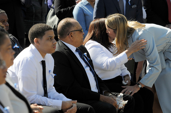 TIM JEAN/Staff photo<br /> <br /> Congresswoman Lori Trahan, right, hugs Rosaly Rondon, the mother of Leonel A. Rondon, sitting with her husband Miguel, and son Leonardi, during a dedication ceremony for Rondon Square. The square is on the corner of Chestnut and Jackson St., Lawrence not far from where Leonel Rondon had lived. Rondon was the single fatality in the Sept. 13, 2018 gas disaster.  9/13/19