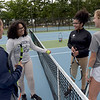 TIM JEAN/Staff photo<br /> <br /> Talking after a game of tennis are from left to right, Merrimack's Kelly Klarn, Lawrence players Joanet Plasencia, Yaslyn Cruz, and Merrimack's Allyson Nerf. The courts at Sullivan Park are now open after the city replaced them after being used for housing trailers during the gas disaster.   9/12/19