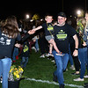 CARL RUSSO/Staff photo Joseph Flaherty and his son, Joe, 3 are greeted by Windham students while walking onto the field during the 9th Annual Windham high Jaguar Blackout Cancer Football Game and half time show. The popular event was held Friday night on September 27. Joseph and Tara Flaherty were being honored along with their son and daughter Nora, 6, who is a cancer survivor and danced during the show. <br /> <br /> Windham-grown Project Blackout kicks off a series of events around the town to generate awareness of pediatric cancer and raise funds to support research efforts and care for the children and families currently battling pediatric cancer in Windham. Students performed at the football game halftime show dedicated to families who have been helped by the project. 9/27/2019
