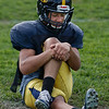MIKE SPRINGER/Staff photo<br /> Running back Josh Ramos stretches his legs during varsity football practice Tuesday at Andover High School. Ramos missed most of last season due to a broken leg.<br /> 9/24/2019