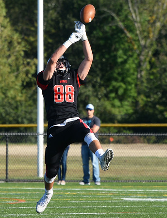 CARL RUSSO/Staff photo. ANDOVERS' MAGAZINE:  North Andover's Max Wolfgang reaches high for the pass but is unable to make the catch. Marblehead defeated North Andover 25-20 in Friday football action. 9/13/2019