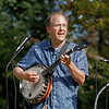 MIKE SPRINGER/Staff photo<br /> Eric Baldwin of Andover plays banjo with the Merrimack Valley Jazz Babies during the St. Michael's Church 150th anniversary picnic Sunday on the North Andover Town Common. The event included games, food and live music.<br /> 9/29/2019