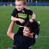 CARL RUSSO/Staff photo Lukas Principe, 12 plays with bis brother Parker, 3 while attending the 9th Annual Windham high Jaguar Blackout Cancer Football Game and half time show with their parents, Jon and Jami Principe. The popular event was held on Friday night, September 27. <br /> <br /> Windham-grown Project Blackout kicks off a series of events around the town to generate awareness of pediatric cancer and raise funds to support research efforts and care for the children and families currently battling pediatric cancer in Windham. Students performed at the football game halftime show dedicated to families who have been helped by the project.<br />  9/27/2019