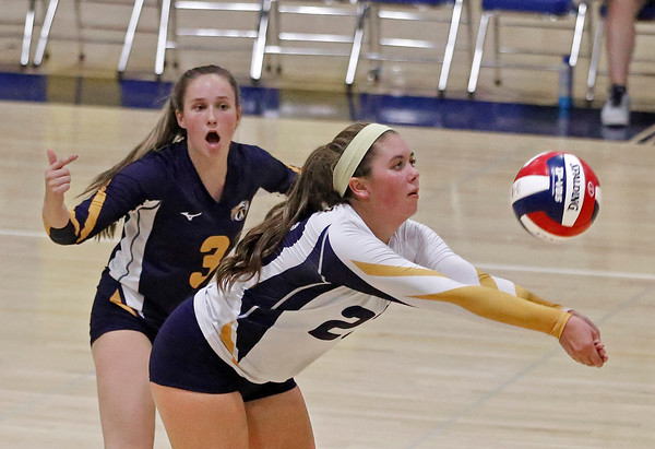 MIKE SPRINGER/Staff photo<br /> Andover's Caroline Fraser hits the ball as teammate Jenny McNaughton looks on during varsity volleyball play Monday against Central Catholic at Andover.<br /> 9/23/2019