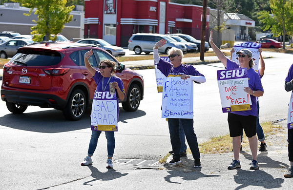 RYAN HUTTON/ Staff photo <br /> Workers wave to traffic on South Union Street in Lawrence on Wednesday morning during a Service Employees International Union strike against Fidelity House CRC outside the company's Lawrence location.