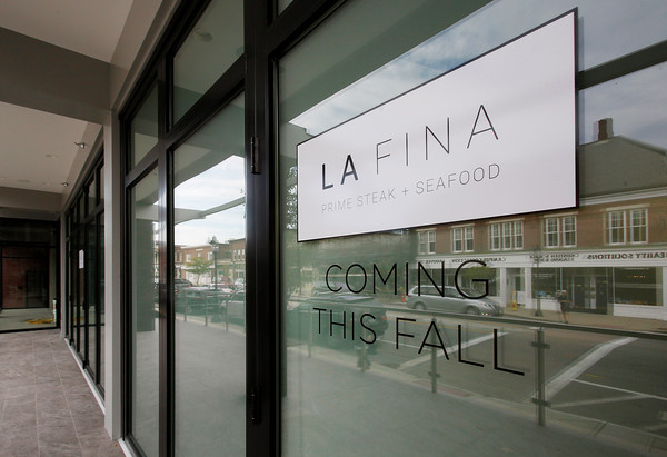 MIKE SPRINGER/Staff photo<br /> A sign outside the building at 27-45 Main Street in downtown Andover announces the upcoming arrival of La Fina, a new restsurant by LaRosa's owner Paul LaRosa.<br /> 9/23/2019