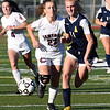 RYAN HUTTON/ Staff photo <br /> Central Catholic's Kate Regan, left, chases down the ball with Andover's Ava Trapp, right, during Thursday's game at Andover High School.
