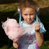 MIKE SPRINGER/Staff photo<br /> Five-year-old Chloe Hood of North Andover enjoys eating cotton candy during the St. Michael's Church 150th anniversary picnic Sunday on the North Andover Town Common. The event included games, food and live music.<br /> 9/29/2019