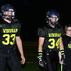 CARL RUSSO/Staff photo Cancer survivor, Rylee Simmons, 11 of Windham is escorted by football captains Bobby Dicicco, left and Riley Desmarais onto the field for the coin toss to start the 9th Annual Windham high Jaguar Blackout Cancer Football Game and half time show, held Friday night on September 27. Rylee battled leukemia when she was 18 months old. <br /> <br /> Windham grown Project Blackout kicks off a series of events around the town to generate awareness of pediatric cancer and raise funds to support research efforts and care for the children and families currently battling pediatric cancer in Windham. Students performed at the football game halftime show dedicated to families who have been helped by the project.  9/27/2019
