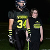 CARL RUSSO/Staff photo Cancer survivor, Rylee Simmons, 11 of Windham is escorted by football captain Riley Desmarais onto the field for the coin toss to start the 9th Annual Windham high Jaguar Blackout Cancer Football Game and half time show, held Friday night on September 27. Rylee battled leukemia when she was 18 months old. <br /> <br /> Windham grown Project Blackout kicks off a series of events around the town to generate awareness of pediatric cancer and raise funds to support research efforts and care for the children and families currently battling pediatric cancer in Windham. Students performed at the football game halftime show dedicated to families who have been helped by the project.  9/27/2019