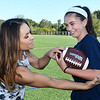 CARL RUSSO/Staff photo. Jen Welter works with Rachel McDevitt, 11, a 6th. grader at the North Andover Middle School, teaching her the fundamentals of football. Jen shows Rachel how to tuck the ball in her arm.<br /> <br /> Jen is a former NFL assistant coach who has made it her mission to promote the sport for girls, teaching fundamentals so girls can play and be successful in flag football. As a coach, Jen wants more girls in the sport. 9/19/2019