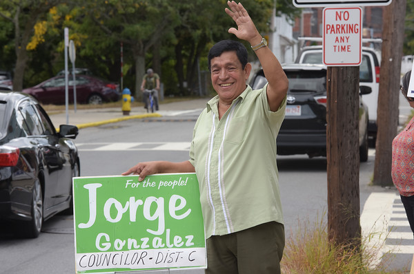 TIM JEAN/Staff photo<br /> <br /> Jorge Gonzalez, a candidate for City Councilor District C waves to voters outside the Arlington School during Tuesday's preliminary election in Lawrence.    9/24/19