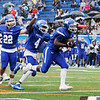 TIM JEAN/Staff photo<br /> <br /> Methuen linebacker Junior Gelin, right, picks up the fumble and runs for a touchdown with his teammates Andrew Downey (22) and Kareem Coleman (4) during a football game against Malden Catholic. Methuen won 47-14.  9/14/19