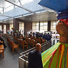 RYAN HUTTON/ Staff photo <br /> A giant Muñecas Limé doll from the Dominican Republic watches over the Cultural Appreciation Week event on the third floor of Lawrence District Court on Monday which celebrates the diversity of the court.