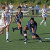 MIKE SPRINGER/Staff photo<br /> Lawrence's Duongdara Kim, right, winds up to hit the ball past Kayleigh Longeneker of Haverhill during varsity field hockey play Wednesday in Haverhill.<br /> 9/18/2019