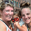 CARL RUSSO/Staff photo. Amber Lachappelle, left of Plaistow with her shy daughter, Teagan-Marie, 3 and family friend Sarah Gondolfo of Haverhill enjoying River Ruckus. Team Haverhill's River Ruckus 2019 was held Saturday in downtown Haverhill on Washington Street. 9/21/2019