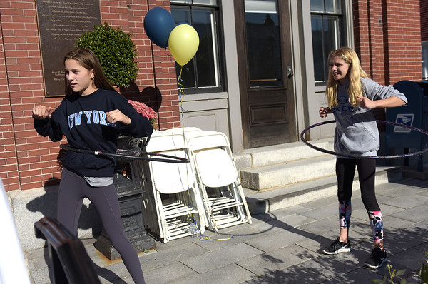 TIM JEAN/Staff photo<br /> <br /> Addison DiAntonio, left, and Neila Foohey, both 12, and of Andover, competes in a hula hoop contest during community gathering on the anniversary of the Sept. 13, 2018 gas disaster outside the Old Town Hall in Andover.  9/13/19
