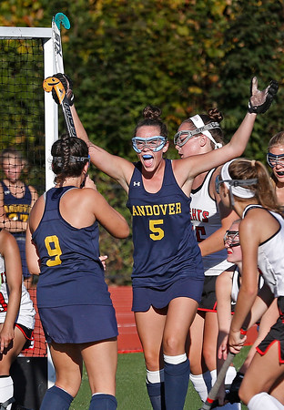 MIKE SPRINGER/Staff photo<br /> Andover's Olivia Beucler raises her hands in celebration after a goal by teammate Heather Graham, left, during a varsity field hockey match Wednesday at North Andover.<br /> 9/25/2019