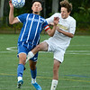 CARL RUSSO/Staff photo. Methuen captain, Rudy Campos, left and Haverhill's Ethan Archamabault fight for the ball. Haverhill defeated Methuen 1-0 in boys soccer action Tuesday afternoon. 9/24/2019