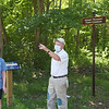 TIM JEAN/Staff photo<br /> <br /> Judy Schneider, left, listens to Pike Messenger as he points towards the Bayley-Bradstreet House on Maple St., built in 1714 while walking along the Target Common Landmark Trail. The trail is organized around historic and natural features in Middleton. 7/21/20