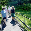 TIM JEAN/Staff photo<br /> <br /> Middleton Stream Team members from left, Judy Schneider, Joan Caulfield, Pike Messenger, and Sandy Rubchinuk walk out of the woods along the Target Common Landmark Trail towards the Flint Public Library.   7/21/20