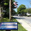 TIM JEAN/Staff photo<br /> <br /> A small sign gives brief history and information of the Flint Public Library and the Estey Tavern across the street seen while walking along the Target Common Landmark Trail. The trail is organized around historic and natural features in Middleton. 7/21/20