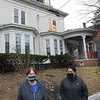 TIM JEAN/Staff photo<br /> <br /> Lisa White, left, and Jacqueline Diaz, where displaced by the Nov. 16 fire at 233 Jackson St., Lawrence. An arson fire destroyed the rooming house and left numerous tenants homeless.     12/1/20