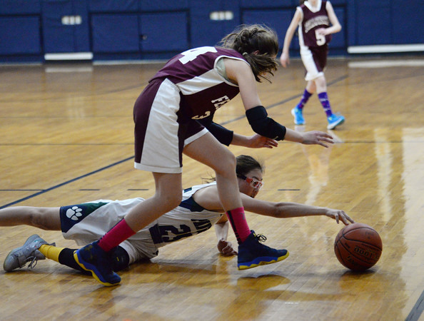 CARL RUSSO/Staff photo Fellowship's Avery Robichaud, left, and PMA's Connie Chong battle for the loose ball. Presentation of Mary Academy defeated Felllowship Christian Academy 51-43 in girls' basketball action Tuesday afternoon. 2/04/2020