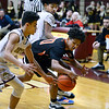CARL RUSSO/Staff photo Greater Lawrence's Wander Languasco, center   fights for the loose ball with Whittier's John Tricoche, left and Angel Rodriguez.  Greater Lawrence Tech. defeated Whittier Tech. 53-42 in boys' basketball action. 2/03/2020