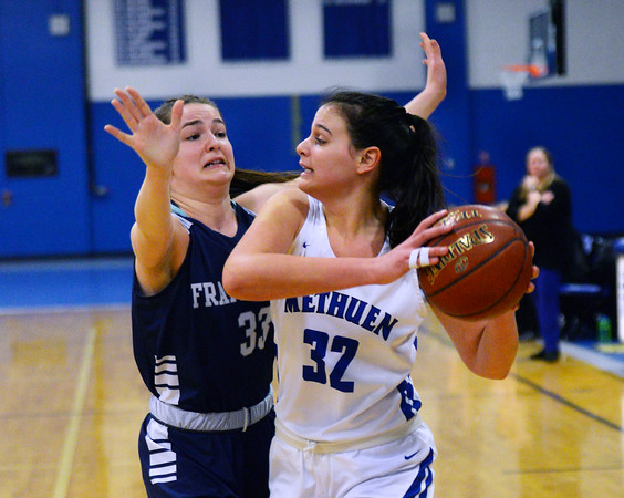 CARL RUSSO/staff photo. Methuen captain, Marren Donovan looks for the open player to pass the ball to. Methuen Rangers defeated Framingham in girls' basketball action Sunday afternoon.  2/9/2020.