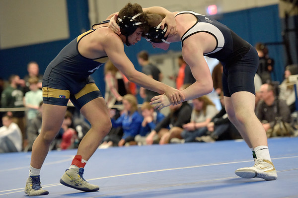 TIM JEAN/Staff photo <br /> <br /> Andover's Elias Maita, left, takes on St. John's Prep Achilles Gikas during the 160 pound match during the MIAA Division 1 wrestling finals at Methuen High School.    2/22/20