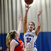 CARL RUSSO/Staff photo Methuen captain, Marren Donovan takes the short jump short over Somerville's defender. Methuen defeated Somerville 61-47 in girls' basketball action Tuesday night. 2/18/2020.