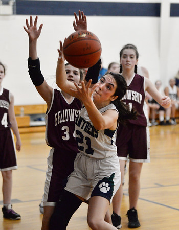 CARL RUSSO/Staff photo PMA's Elaina Latino battles for the rebound with Fellowship's Avery Robichaud. Presentation of Mary Academy defeated Fellowship Christian Academy 51-43 in girls' basketball action Tuesday afternoon. 2/04/2020